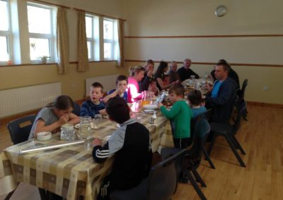 Children eating soup in Benwiskin Centre after Ballintrillick Clean Up