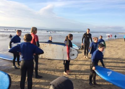 Cubs with surf boards Rossnowlagh