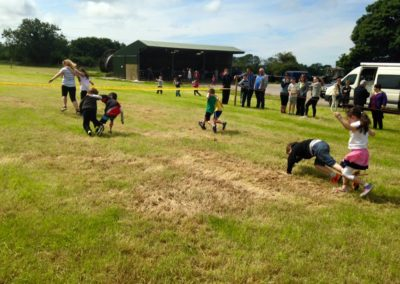 Children doing 3 legged race in Ballintrillick