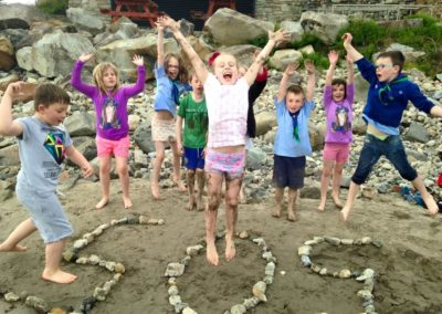 Beavers learning how to do SOS signs on beach Mullaghmore